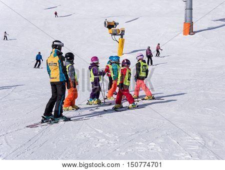 SOLDEN, AUSTRIA - MARCH 4, 2016: Ski school for children in Solden ski resort in Austrian Alps