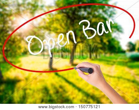 Woman Hand Writing Open Bar With A Marker Over Transparent Board