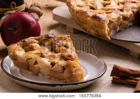 Apple Pie Slice On Rustic Setting