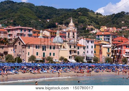 SAN TERENZO LERICI ITALY - JULY 16 2011: San Terenzo (St. Terenzo) beach crowded with bathers in a July day. Lerici in the Gulf of La Spezia Liguria Italy