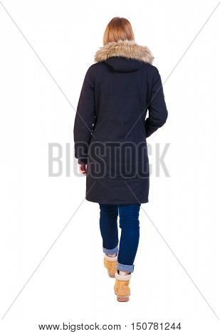 Back view of going  woman in parka. walking young girl. Rear view people collection.  backside view of person.  Isolated over white background. The girl in a jacket with a fur top is