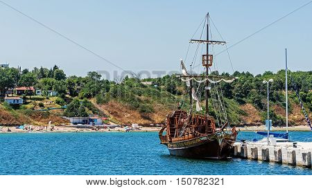 CHERNOMORETS, BULGARIA - JULY 25, 2016: Galleon styled ship moored at the quay in the marina of Chernomorets, city on the Black Sea coast, earlier known as Sveti Nikola (Saint Nicholas).