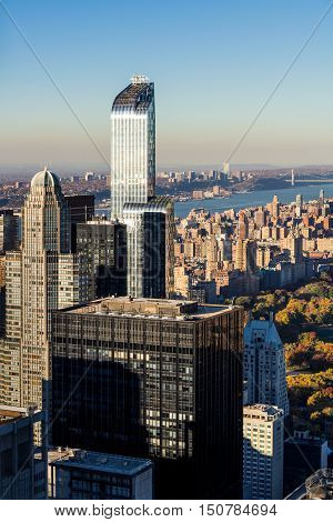 Aerial Autumn view of Midtown and Upper West Side skyscrapers. The view includes Central Park, the Hudson River and the George Washington Bridge