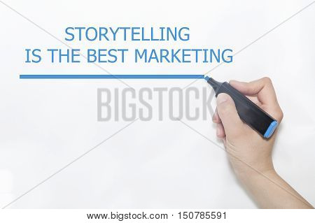 Women Hand writing Storytelling is the best Marketing with marker.