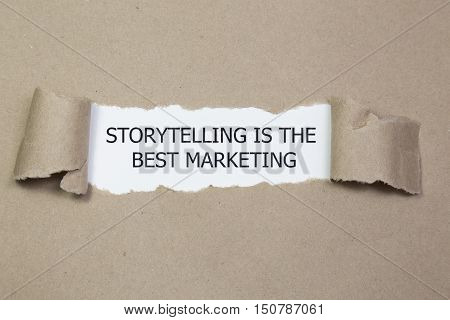 The motivational quote Storytelling is the best Marketing appearing behind torn paper.