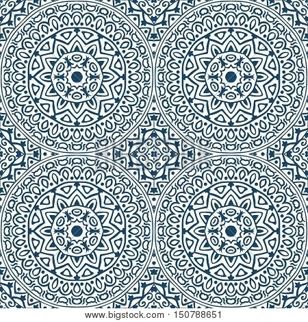 Vector seamless pattern with blue round ornament. Abstract monochrome background with mandala motives
