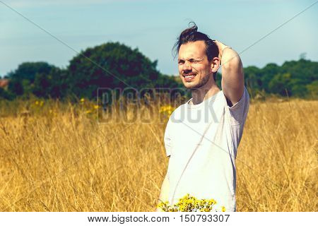 Man Standing In Field Of Dry Grass
