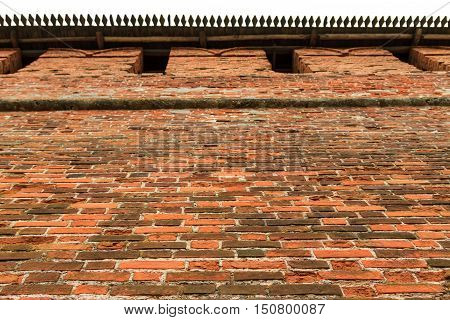 Old red brick city wall part of rampart or vallum horizontal view
