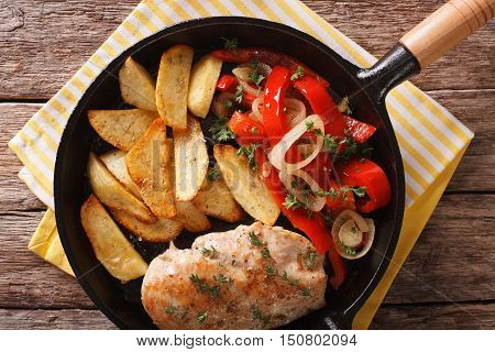 Sizzling Chicken With Roasted Potatoes And Pepper Close-up On A Pan. Horizontal Top View