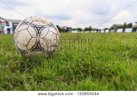 Nakhon Ratchasima Thailand - October 1 : Muddy soccer ball on a football field in Municipal Stadium Nakhon Ratchasima on October 1 2016 in Thailand.