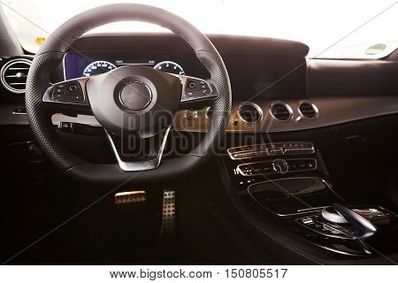 Luxury car Interior. Steering wheel and dashboard