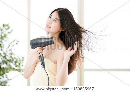 Asian Beauty Woman Hair Dryer To Drying Hair After Shower