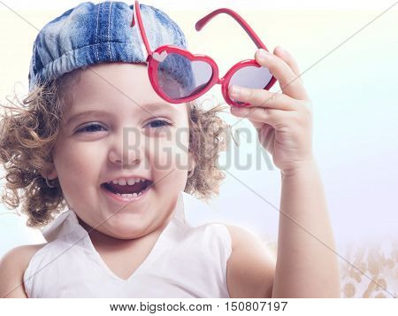 Smiling Child With Holding Red Sun Glasses