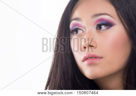 Portrait of a beautiful brunette with colored eyes and light lipstick