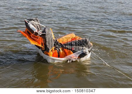 Dutch rescue demonstration life raft opening in the water