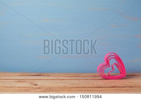 Valentine's day rustic background with pink heart shape and copy space