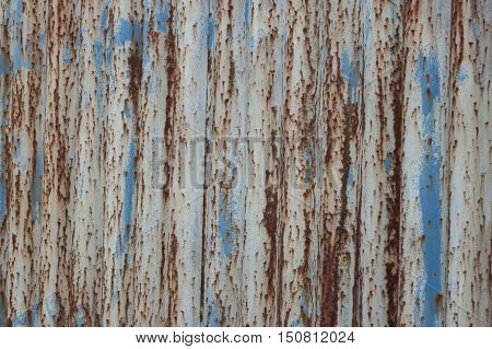 Detailed view of an old metal fence, which succumbed to corrosion.