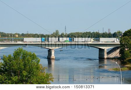 NARVA, ESTONIA - AUGUST 21, 2016: Bridge of Friendship over The Narva (Narova) River between Narva Town in Estonia and Ivangorod in Russia. Here is the border of two countries. View from Estonian side