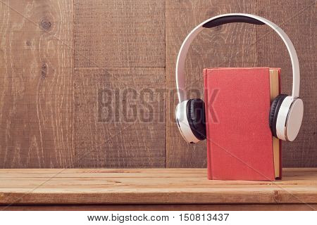 Audio books concept with old book and headphones