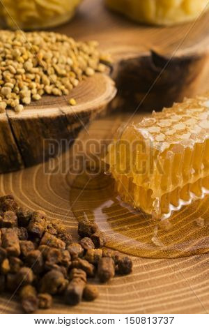 honeycomb pollen and propolis on wooden background