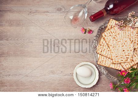 Passover background with matzah seder plate and wine. View from above