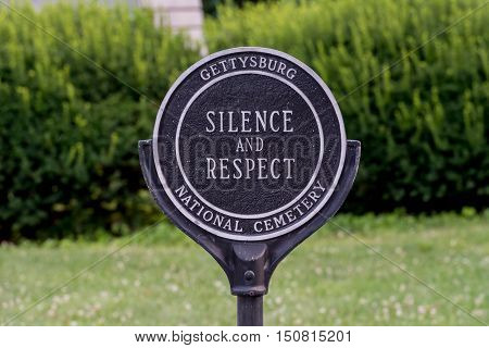 Silence and Respect sign in cemetery reminds visitors