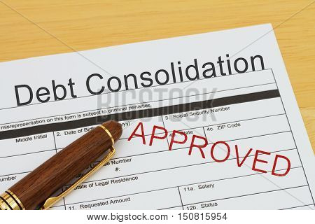Applying for a Debt Consolidation Loan Approved Debt Consolidation Loan application form with a pen on a desk with an approved stamp
