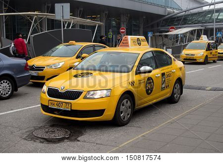 Moscow, Russia - November 07, 2015: Yellow taxi stand at the entrance of the airport Sheremetyevo.