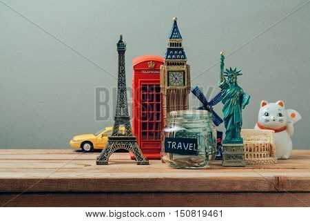 Travel and tourism concept with souvenirs from around the world. Planning summer vacation money budget trip concept. Saving money for vacation.