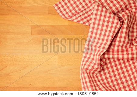 Tablecloth on wooden kitchen table with copy space. View from above