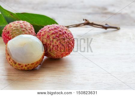 Litchi (lichee) on a wooden floor.The fruit is sweet and sour.