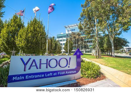 Sunnyvale, California, United States - August 15, 2016: Yahoo Headquarters with American Flag and Yahoo icon.Yahoo is a company providing internet services founded in 1994 by David Filo and Jerry Yang