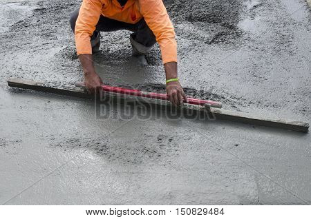Builder is leveling cement during upgrade to residential street.