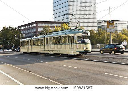 FRANKFURT GERMANY - OCT 21 2009: historic streetcar trolley at the Friedensbrücke in Frankfurt in Germany Frankfurt on a museum ride.