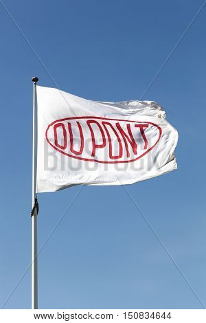 Aarhus, Denmark - May 16, 2016: Flag of the brand Du Pont. DuPont is one of America's most innovative companies and it is an American chemical company that was founded in July 1802 as a gunpowder mill