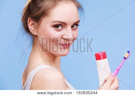 Woman Holds Toothbrush And Paste For Teeth Cleaning