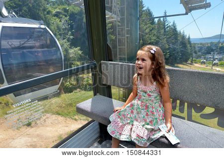 Girl travel on Gondola Cableway on Mount Ngongotaha in Rotorua New Zealand.