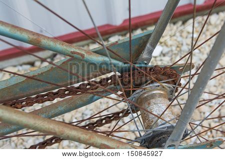 Close up of a rusty rear sprocket on a vintage bicycle