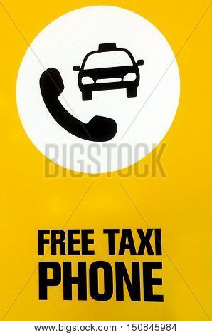 Free taxi phone with a picture of a phone and taxi. Signs and symbols