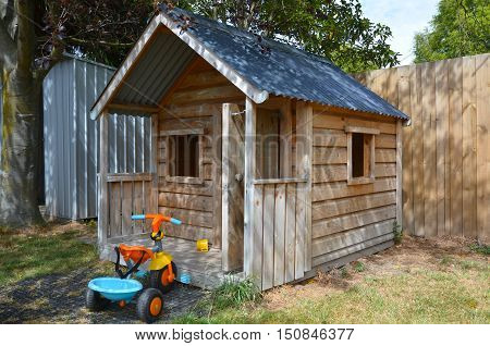 Children playhouse in the yard. Childhood concept