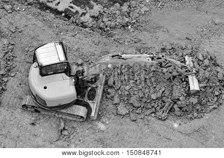 Excavator Digs Soil In A Construction Site