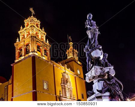 Our Lady of Guanajuato Paz Peace Statu Night Stars Guanajuato Mexico. Statue donated To City by Charles V Holy Roman Emperor in the 1500s. Steeple Towers Basilica de Nusetra Senora Guanajuato Mexico