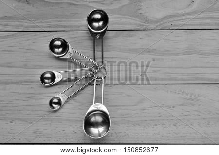 Flat lay of stainless steel measuring spoon set. Cooking concept poster