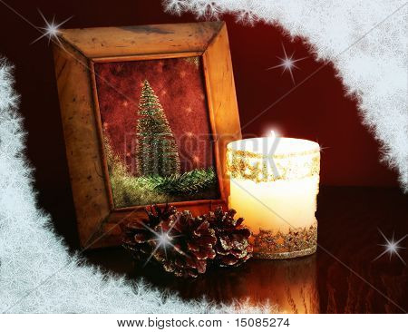 christmas card, vintage photo-frame on a table at candlelight