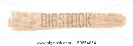 Flap burlap isolated on white background. Top view. Fabric Patch Piece, Rustic Hessian sack Cloth.