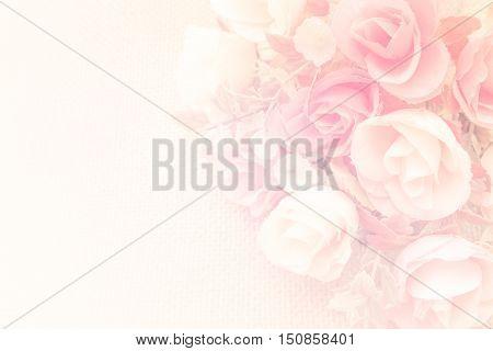 Bouquet of orange roses soft blur background in vintage pastel tones.