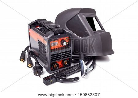 Inverter welding machine, welding equipment isolated on a white background, welding mask, high-voltage wires with clips, set of accessories for arc welding