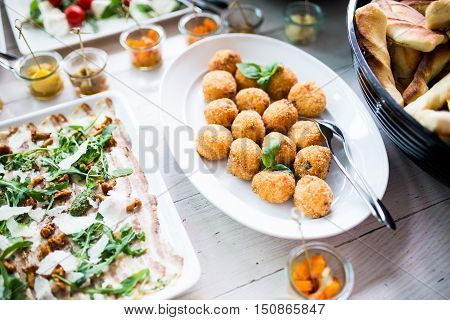 Finger food and snacks at lunch buffet in restaurant