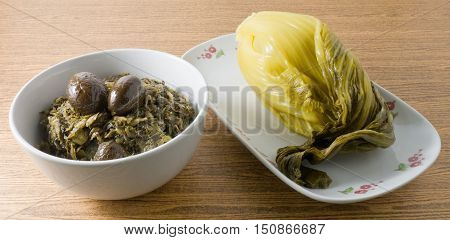 Chinese Traditional Food Delicious Chopped Pickled Chinese Cabbage with Chinese Olives in A Bowl.