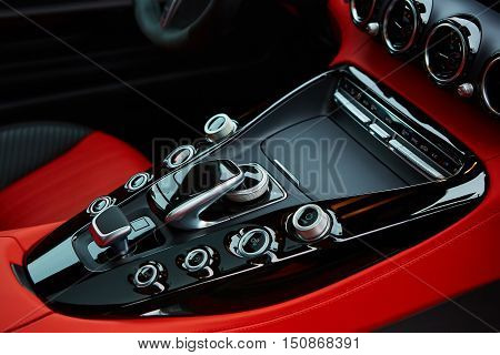 Detail of modern car interior, gear stick, automatic transmission in expensive car